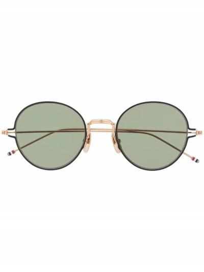 Thom Browne Eyewear солнцезащитные очки в круглой оправе TB915 - 1