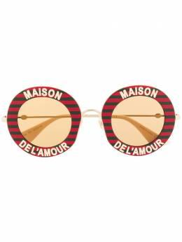 Gucci Eyewear солнцезащитные очки Maison de L'Amour в круглой оправе 470459I3330