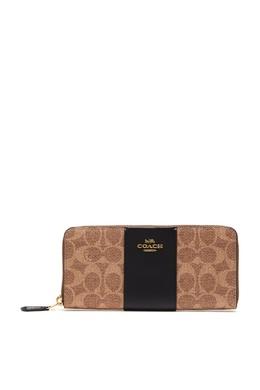 Бежевый кошелек с монограммами Coach 2219172947
